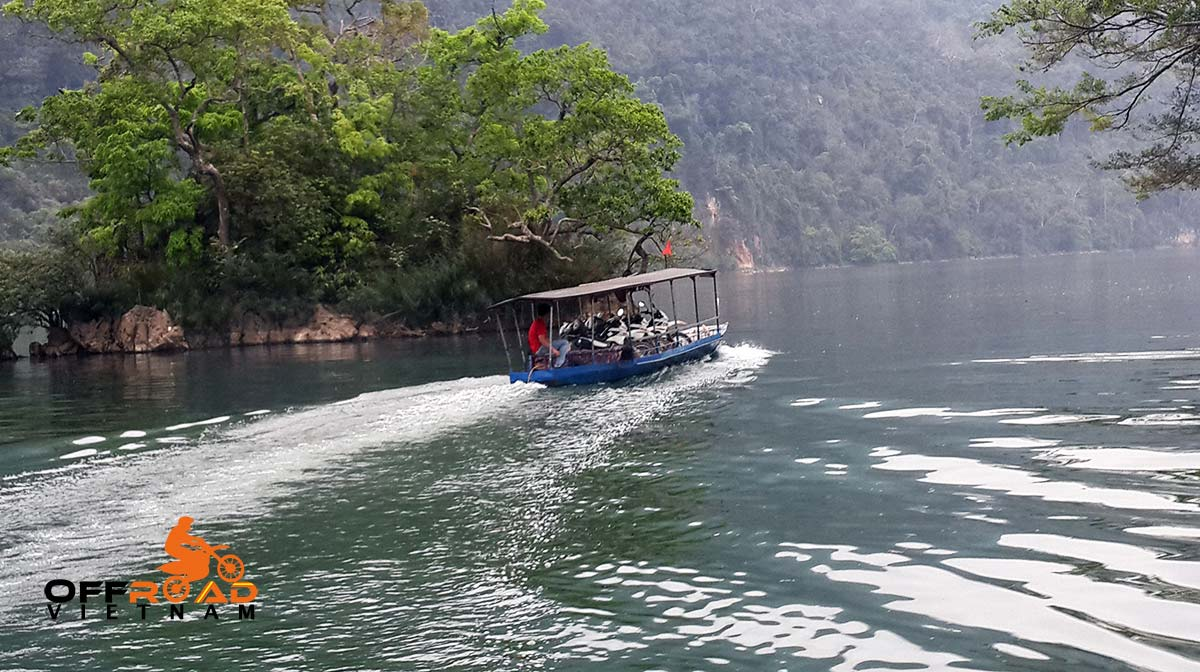 Motorbike Vietnam Adventure Tours - Full North Loop: Ba Be baot cruise with motorbike on the boat.