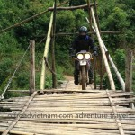 Vietnam motorbike tours over a local bamboo bridge