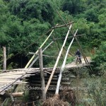 Vietnam motorcycle tours over a local bamboo bridge