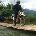 Vietnam relaxing enduro tours over a local bamboo bridge